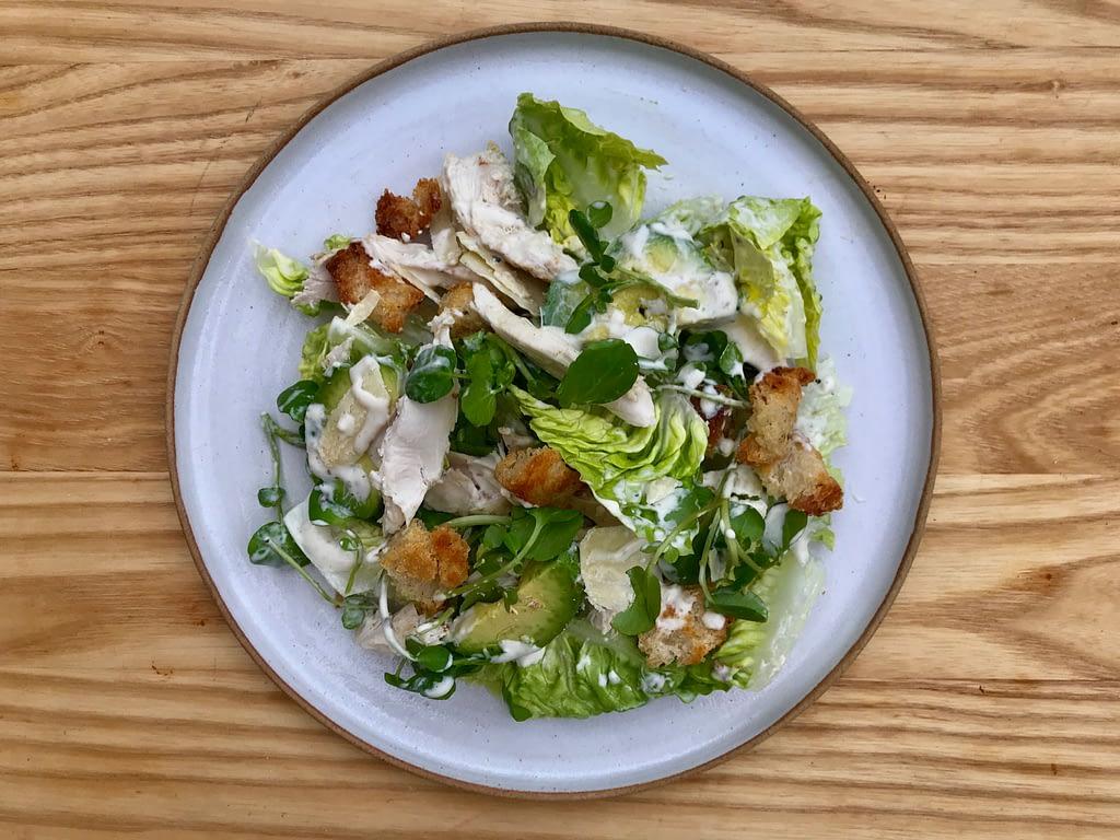 Chicken and avocado Caesar salad