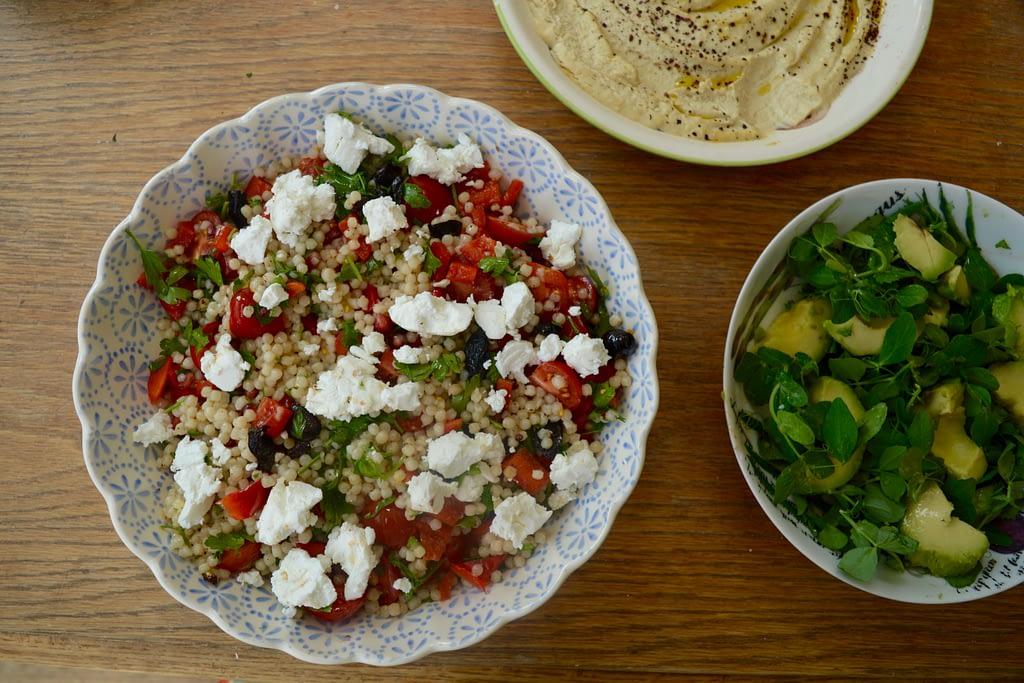 Feta, tomato and couscous salad, hummus and avocado salad